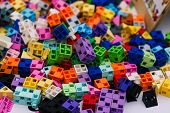 Details Of The Childrens Designer. Scattered Colored Plastic Blocks Of The Designer On The Table. Ch poster