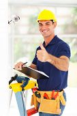 stock photo of cctv  - professional cctv camera technician thumb up after installation - JPG