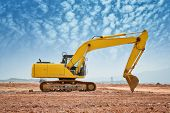 stock photo of power-shovel  - excavator loader machine during earthmoving works outdoors - JPG