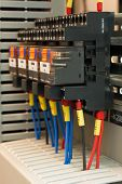 stock photo of contactor  - Close up of electrical relays mounted on a DIN rail - JPG