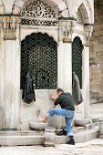Muslim man prapering for prayer in Istanbul Turkey