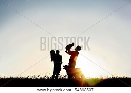 Silhouette Of Happy Family And Dog poster