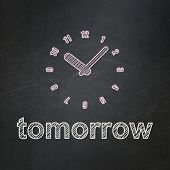 Time concept: Clock and Tomorrow on chalkboard background