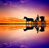 foto of carriage horse  - illustration of a Carriage ride at sunset - JPG