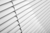 picture of jalousie  - White plastic window blinds close studio shot - JPG