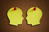 picture of cognitive  - Head shape paper note reminder with thumb tack pin on cork board concept for face off - JPG