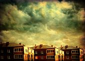 image of outdated  - Vintage Photo Landscape of Small Town with Dramatic Clouds - JPG