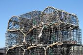 pic of lobster trap  - Lobster or creel pots neatly stacked by the seafront in a Scottish fishing port - JPG