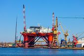 stock photo of shipyard  - Platform in repair in shipyard of Gdansk Poland - JPG