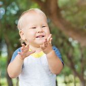 pic of laughable  - Cute caucasian baby outdoor portrait - JPG