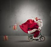 picture of christmas claus  - Fast Santa Claus on a small bike - JPG