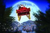 picture of santa sleigh  - Santa flying his sleigh against christmas village under full moon - JPG