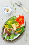 pic of nasturtium  - Fresh colorful salad garnished with edible orange nasturtium flowers - JPG