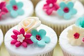 image of sugarpaste  - Wedding cupcakes decorated in fuchsia and turquoise - JPG