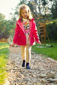 pic of sensory perception  - Five year old girl walking over pebbles - JPG