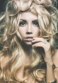 foto of perm  - Beautiful woman with magnificent blond hair - JPG
