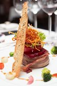 pic of chateaubriand  - Elegant tenderloin steak with steamed vegetables topped with deep fried onion tomato and herbs - JPG