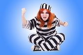 stock photo of prison uniform  - Prisoner in striped uniform on white - JPG