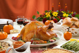 picture of pumpkin pie  - Roasted turkey on a server tray garnished with fresh figs grape kumquat and herbs on fall harvest table - JPG