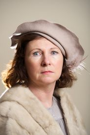 stock photo of taupe  - Brunette in taupe hat and fur stole - JPG