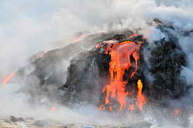 pic of magma  - Red and Orange magma flowing from Hawaiian volcano into the Pacific Ocean - JPG