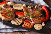 foto of grill  - Grilled steak pork with mushrooms and peppers on the pan grill close up - JPG