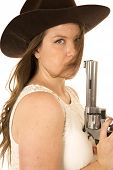 stock photo of pistols  - Serious cowgirl holding pistol hair in face - JPG