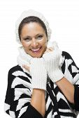 pic of snuggle  - Attractive elegant woman in winter fashion snuggling down into her white scarf and black and white jumper to ward off the cold winter weather on white - JPG