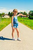 stock photo of denim wear  - Summer portrait of a little girl of 6 years old - JPG