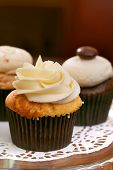 stock photo of sugarpaste  - Gourmet cupcakes baked and frosted with icing vanilla - JPG
