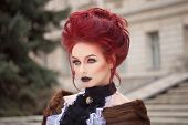 foto of gothic hair  - sexy woman with gothic makeup and red hair and castle - JPG