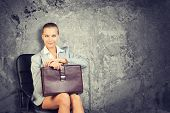 picture of blouse  - Woman wearing jacket and blouse holding briefcase - JPG