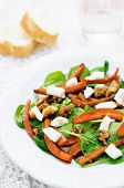 stock photo of walnut  - salad with spinach mozzarella walnuts and caramelized carrots - JPG