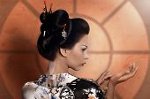 stock photo of geisha  - Portrait of a Japanese geisha young beautiful woman - JPG