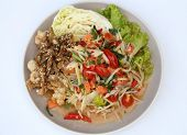foto of green papaya salad  - papaya spicy salad with salmon on white table in restaurant - JPG