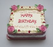 picture of fancy cake  - Happy birthday is written in square cake - JPG