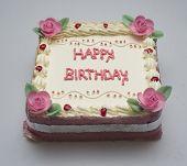 stock photo of fancy cake  - Happy birthday is written in square cake - JPG