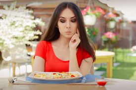 picture of big-girls  - Beautiful girl Making Nutrition Decisions in a Restaurant - JPG