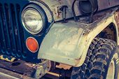pic of muscle-car  - Headlight of a vintage car  - JPG