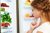picture of refrigerator  - Happy woman standing at the open refrigerator with fruits vegetables and healthy food - JPG