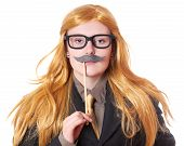 stock photo of moustache  - young woman with fake moustache dressed up as a man - JPG