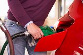 picture of petrol  - Refuelling a car at a petrol station - JPG