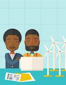 stock photo of generator  - Two black workers using laptop with windmills as power generator - JPG