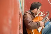 pic of rockabilly  - man with guitar in the street - JPG