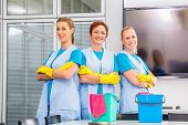 picture of work crew  - Cleaning brigade working in office - JPG