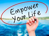image of empower  - Man Hand writing Empower your Life with black marker on visual screen - JPG