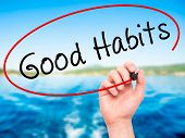 picture of  habits  - Man Hand writing Good Habits with black marker on visual screen - JPG