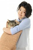 image of sleeping bag  - An attractive young teen happily carrying her sleeping cat in a woven shoulder bag - JPG