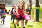 image of fancy-dress  - Children In Fancy Costume Dress Going Trick Or Treating - JPG