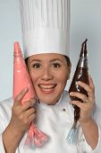picture of whipping  - Woman cook holding a chocolate strawberry whipped cream cone portrait - JPG